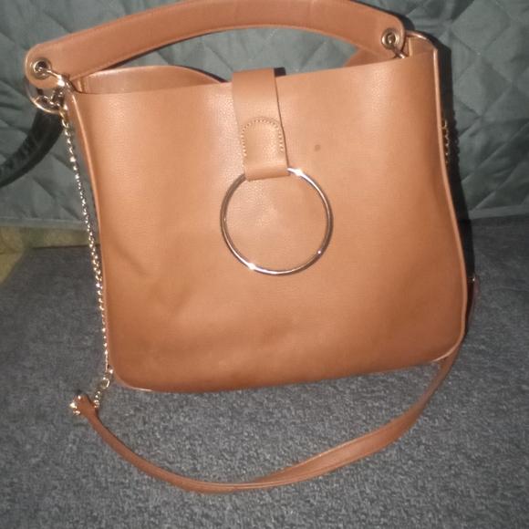 Tan faux leather bag.